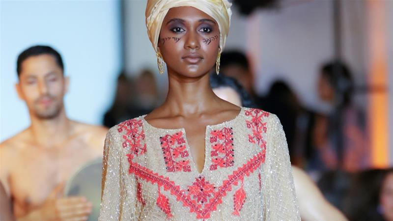 Bedouin women 'misled' into embroidering gown forNYFW