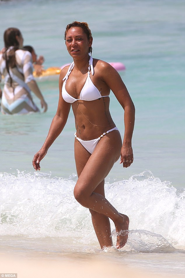 PICTURES: Mel B suffers abusive words from fans as she models in bikini